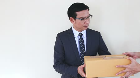giveaway : asian businessman receive a postmail brown box  repeat business ideas concept Stock Footage