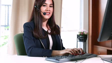 asian operator woman with headset while working communication concept