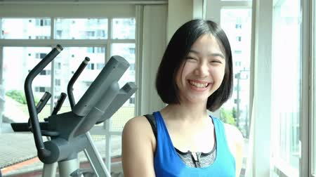 young happiness asian woman enjoy and laugh in fitness health center slow motion