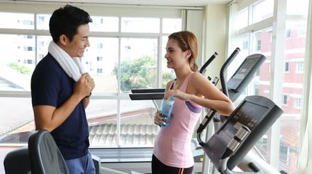 man and woman are talking  while workout at fitness with happiness moment