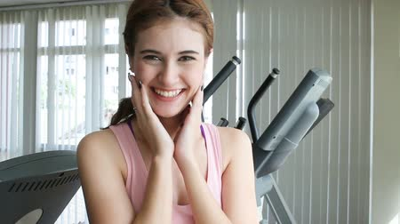 caucasian woman happily laughing after working out in fitness center Stock mozgókép