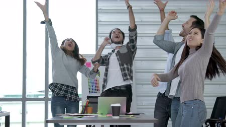 successful teamwork dance with happiness after closed big business deal in office