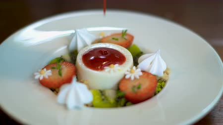 fruit pudding with fresh strawberry and cracker with red berry sauce