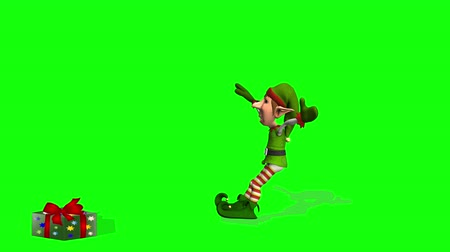 manó : Dancing Elf with Jump  --  Green & red attired elf dances ballet, jumps onto a Christmas present, turns to the audience and bows. Animation has shadow. Background is a green screen.