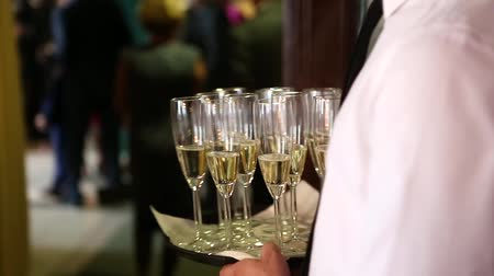reception : Glasses of champagne at a wedding reception to welcome the bride and groom