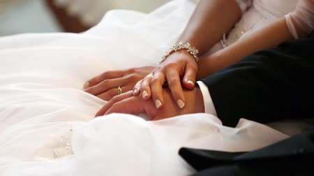 templombúcsú : Hands of bride and groom with rings after wedding ceremony in church