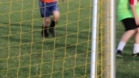 teen action : Young boys play football match Stock Footage