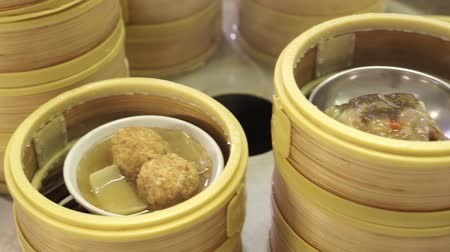 cooking pots : Steaming Dim Sum , Chinese food