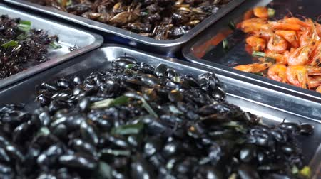 krewetki : Fried insects such as grasshopper are typical Thai street food