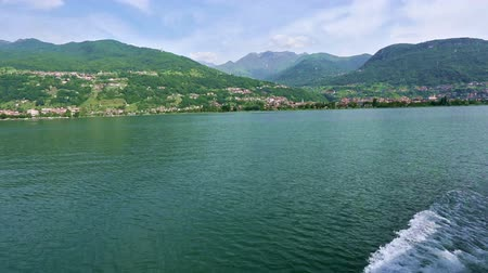 olhando a câmera : Lake Como (Italy) summer  view from ship board