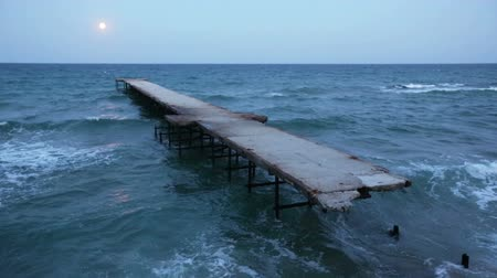 elpusztított : Full moon night ruined pier and Black sea coast Bulgaria. Stock mozgókép