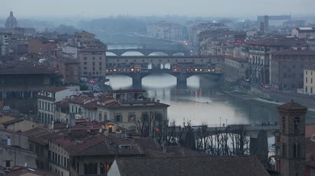 florencja : Evening  winter Florence City top view Italy, Tuscany on Arno river. All people are unrecognizable.