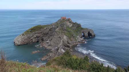 gaztelugatxeko doniene : Doniene Gaztelugatxeko hermitage on top of Gaztelugatxe island. Biscay, Basque Country (Spain). Dates from the 10th century. All people are unrecognized.