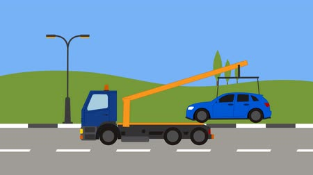 wrecker : Tow truck picking up a car in town