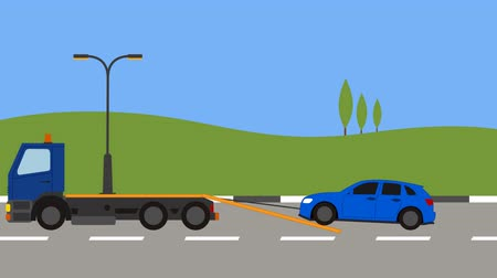 truck crane : Tow truck picking up a car in town
