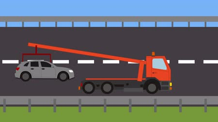 wrecker : Tow truck picking up a vehicle on the road