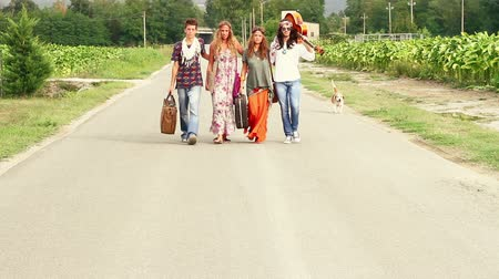 hippi : Hippie Group Walking on a Countryside Road