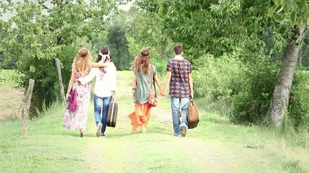 kufr : Hippie Group Walking on a Countryside Road