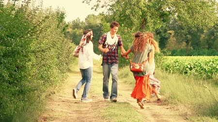 hippie : Hippie Group Playing Music and Dancing Outside Stock Footage