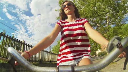 bisiklete binme : Young Woman Going by Bike