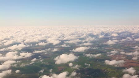 folga : Aerial view of countryside and cloudscape from window seat Stock Footage