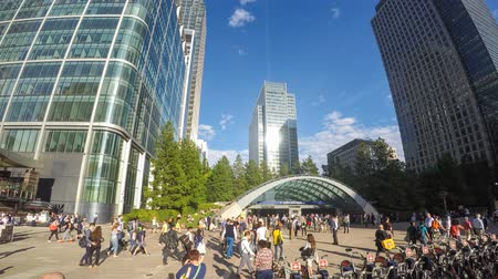 capital cities : LONDON, UK - AUGUST 21, 2015: Commuters and tourists in Canary Wharf main square, time lapse