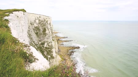 cliff : White cliffs of Dover view from the top. Famous nature landmark in Kent, UK, facing the sea. Travel and nature concepts. Stock Footage