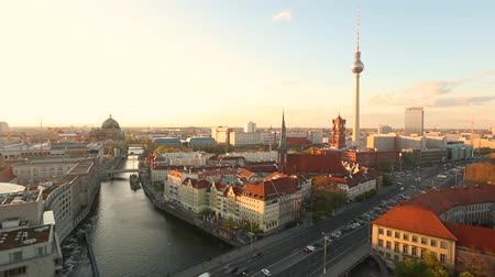dom : Berlin aerial view at sunset, time-lapse. Berlin Cathedral on the left, tv tower on the right. Golden light over Berlin rooftops in the late afternoon. Travel and architecture concepts Stock Footage