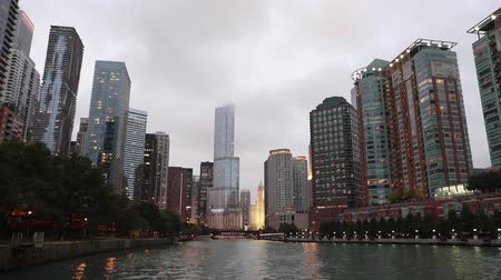 Chicago waterfront view with skyscrapers and clouds. Modern buildings along a water canal in Chicago, low and wide angle view. Architecture and travel concepts