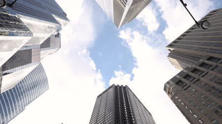 Skyscrapers bottom view looking up at the sky. Warm eye view of modern buildings in Chicago, with bright cloudy sky on background. Travel and architecture concepts Wideo