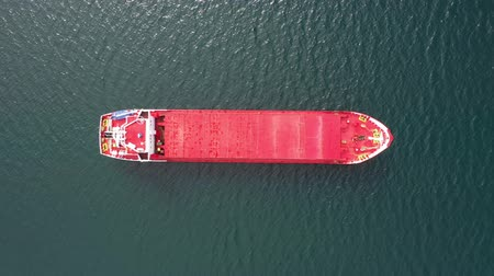 Aerial top view of nautical vessel in Scotland - Boat on a Scottish loch, a lake connected to the sea - Transportation and nature concepts