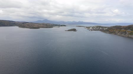 Aerial view of Skye Bridge and Isle of Skye on background - Drone view over the water with Scotland on the right