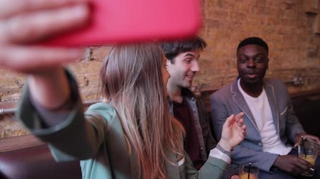 grimacing : Happy friends having fun at bar and taking a selfie - Multiracial group enjoying time at pub restaurant drinking together - Funny people smiling and laughing, happy lifestyle