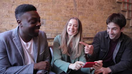 grimacing : Happy friends having fun at bar and looking at smartphone - Multiracial group enjoying time at pub restaurant drinking together - Funny people smiling and laughing, happy lifestyle Stock Footage
