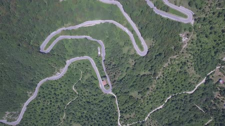 retorcido : Aerial view of a winding mountain road in Italy. Green woods along a scenic and beautiful road leading to Bocca Trabaria pass on a sunny day