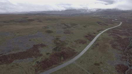 Aerial view of countryside road in Wales on a cloudy day. Adventure and travel concepts during fall season in the UK