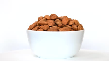 abur cubur : Almonds in bowl rotating on white background