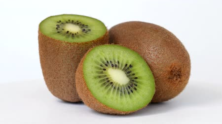 Whole kiwi and halfes rotating on white background Dostupné videozáznamy