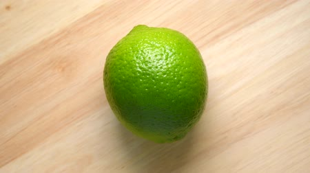 Lime rotating top view on wooden background