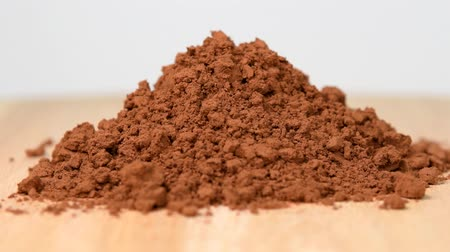 Pile of cocoa powder rotating