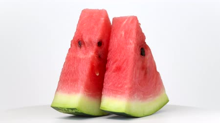 Watermelon slices rotating on white background