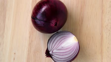 Red onion rotating top view on wooden background