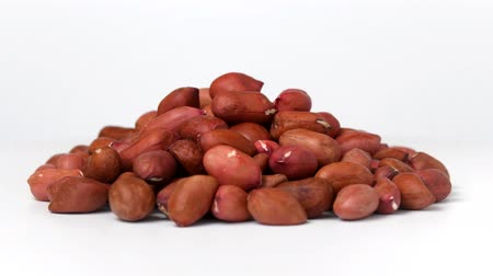 Pile of peanuts rotating on white background