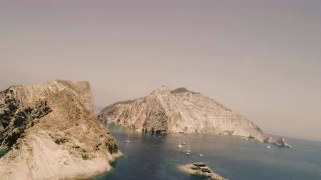 looking far away : Landscape of Palmarola Island in Italy with cliff and boats