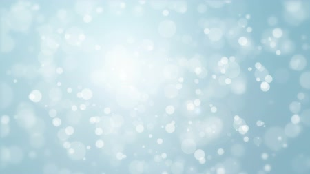 srebro : Beautiful soft silver blue background with moving light particles creating a bokeh effect.