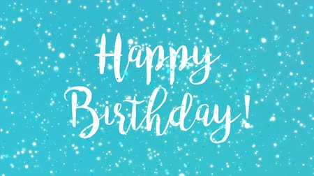 turkuaz : Sparkly Happy Birthday greeting card video animation with handwritten text and colorful glitter particles flickering on turquoise blue background.