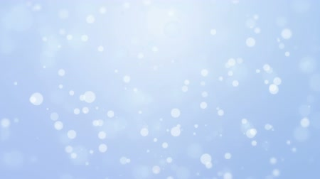 ezüst : Glowing abstract white blue holiday background with flickering bokeh lights. Stock mozgókép
