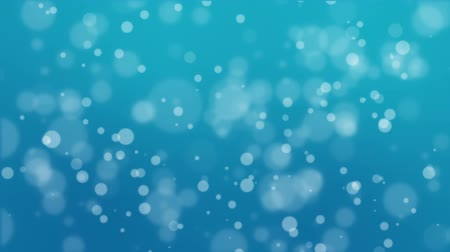 чирок : Animated turquoise blue bokeh background with floating light particles. Стоковые видеозаписи