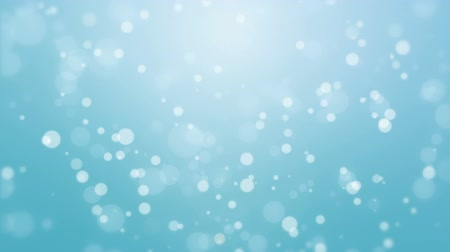 чирок : Beautiful light blue holiday background with flickering bokeh particles.