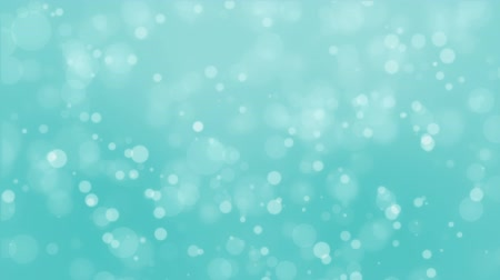 чирок : Magical teal blue glowing bokeh background with floating light particles. Стоковые видеозаписи